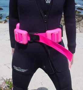 Diver wearing hard weight belt.
