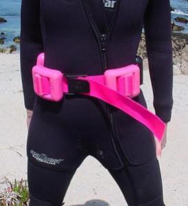Diver wearing hard weight belt.